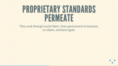 Text Slide: 'Proprietary standards permeate: They soak through social fabric, from government to business, to citizen, and back again.'