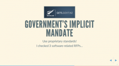 Text Slide: 'Government's Implicit Mandate: Use proprietary standards!' Includes the NZ Gov'ts Government Electronic Tendering System's logo, GETS.govt.nz